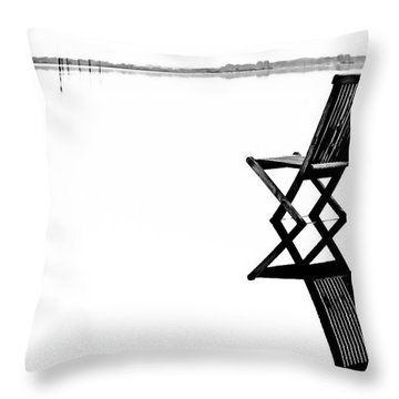 Old Chair In Calm Water Throw Pillow by Gert Lavsen