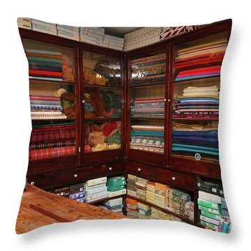 Old-fashioned Fabric Shop Throw Pillow by Gaspar Avila