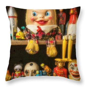 Old Toys Sitting On Shelf Throw Pillow