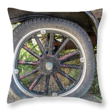 Old Truck Tire In Rural Rocky Mountain Town Throw Pillow by Peter Ciro