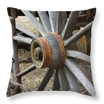 Throw Pillow featuring the photograph Old Waagon Wheel by Phyllis Denton