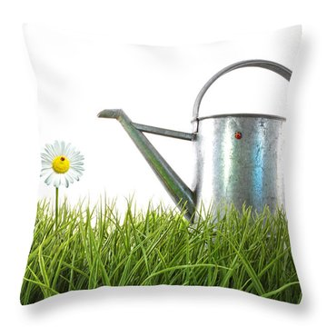 Old Watering Can In Grass With White Throw Pillow by Sandra Cunningham