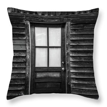 Old Wood Door And Light Black And White Throw Pillow by Terry DeLuco