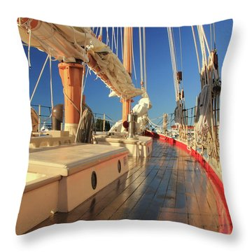 On Deck Of The Schooner Eastwind Throw Pillow by Roupen  Baker