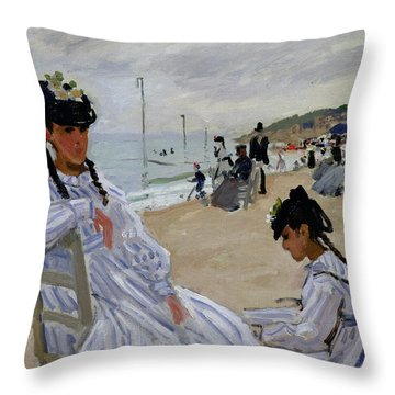 On The Beach At Trouville Throw Pillow by Claude Monet
