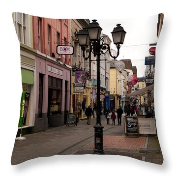 On The Street In Cork Throw Pillow by Rae Tucker