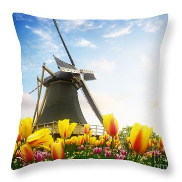 One Dutch Windmill Over  Tulips Throw Pillow