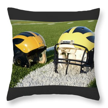 Throw Pillow featuring the photograph One Old, One New Wolverine Helmets On The Field by Michigan Helmet