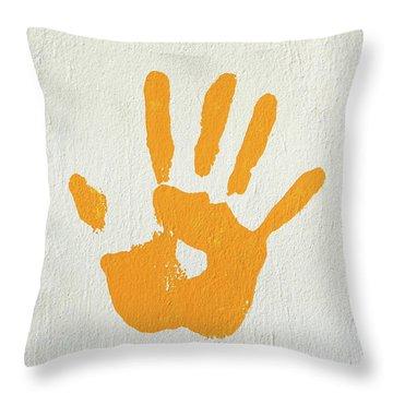 Orange Handprint On A Wall Throw Pillow