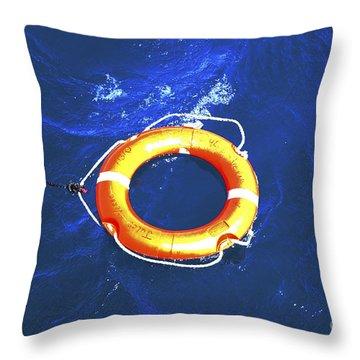 Orange Life Buoy In Blue Water Throw Pillow by Jacki Costi