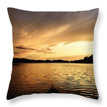 Throw Pillow featuring the photograph Paddling At Sunset On Kekekabic Lake by Larry Ricker