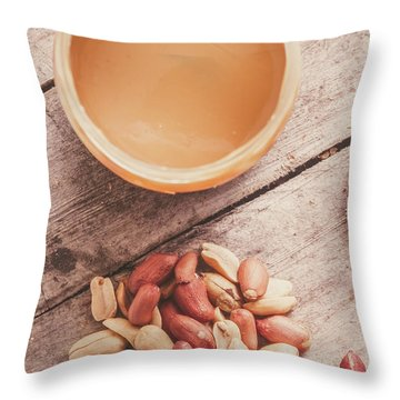Peanut Butter Jar With Peanuts On Wooden Surface Throw Pillow