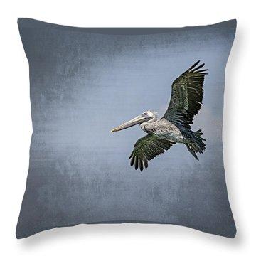 Pelican Flight Throw Pillow by Carolyn Marshall