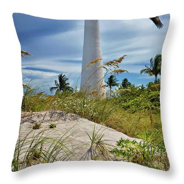 Throw Pillow featuring the photograph Pelican Flying Over Cape Florida Lighthouse by Justin Kelefas