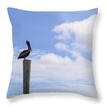 Pelican In The Clouds Throw Pillow by Christopher L Thomley