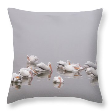 Pelicans On The Lake Throw Pillow by Carolyn Dalessandro