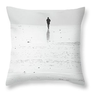 Person Running On Beach Throw Pillow