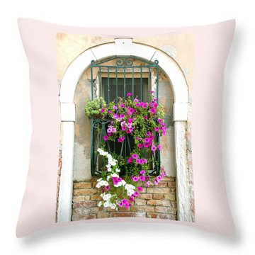 Throw Pillow featuring the photograph Petunias Through Wrought Iron by Donna Corless