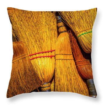 Pile Of Whisk Brooms Throw Pillow
