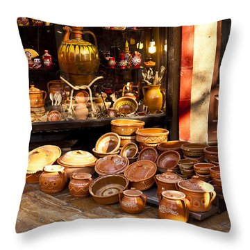 Pottery In The Bazaar Throw Pillow by Rae Tucker