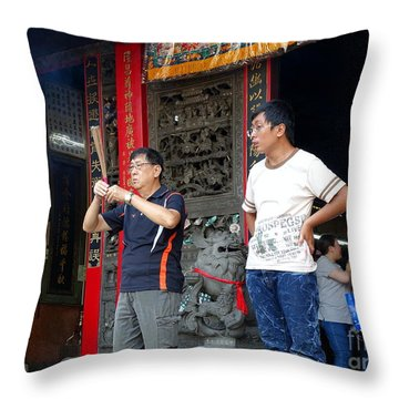 Throw Pillow featuring the photograph Praying At A Temple In Taiwan by Yali Shi