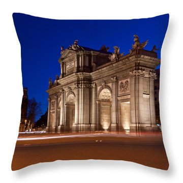 Throw Pillow featuring the photograph Puerta De Alcala by Stephen Taylor