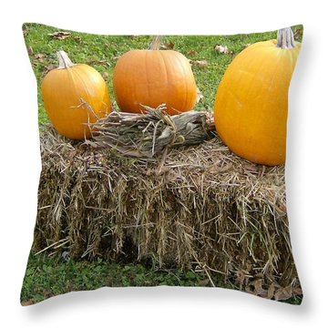 Throw Pillow featuring the photograph Pumpkins On A Haystack by Skyler Tipton