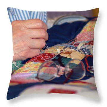Throw Pillow featuring the photograph Quilter's Hands by Wanda Brandon