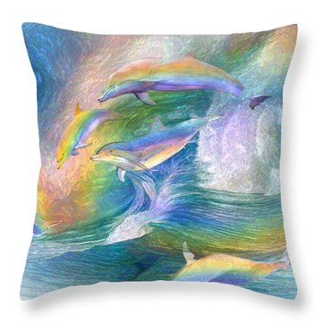 Rainbow Dolphins Throw Pillow by Carol Cavalaris