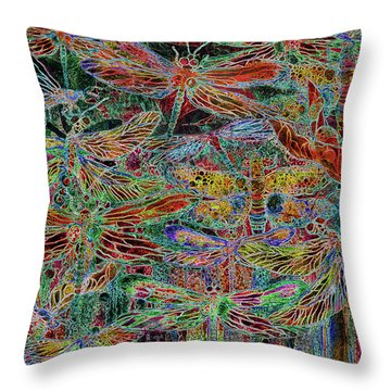 Rainbow Dragonflies Throw Pillow by Carol Cavalaris