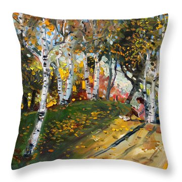 Reading In The Park  Throw Pillow by Ylli Haruni