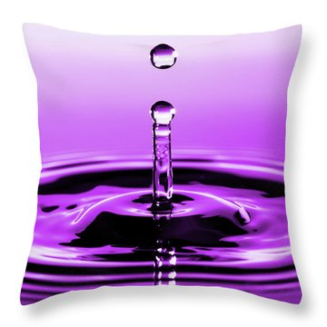 Rebounding Droplet Throw Pillow