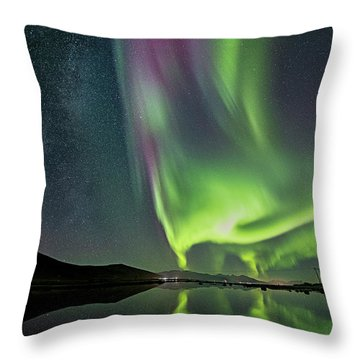 Red Auroras And A Faint Milky Way Throw Pillow