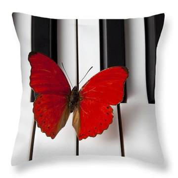 Red Butterfly On Piano Keys Throw Pillow