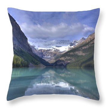 Red Canoe On Lake Louise Throw Pillow by Larry Whiting