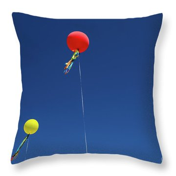Throw Pillow featuring the photograph Red,yellow Balloon Blowing By The Wind In The Air With The Blue  by Jingjits Photography