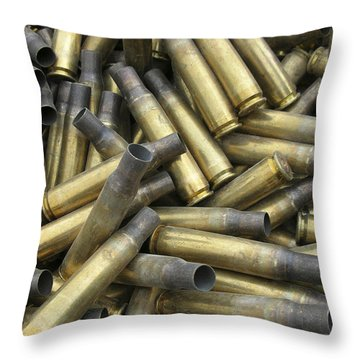 Residual Ammunition Casing Materials Throw Pillow by Stocktrek Images
