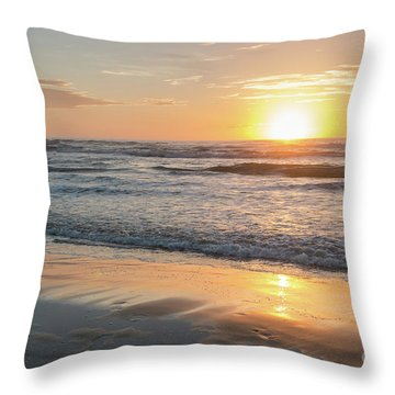 Rising Sun Reflecting On Wet Sand With Calm Ocean Waves In The B Throw Pillow