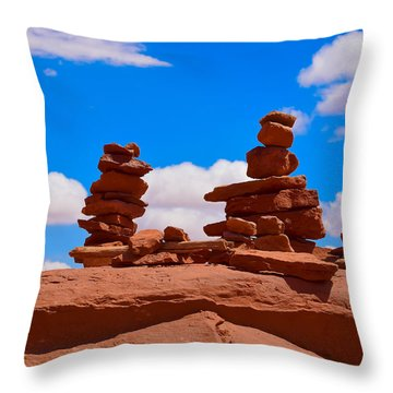Throw Pillow featuring the photograph Rock Cairns In The Desert by Dany Lison