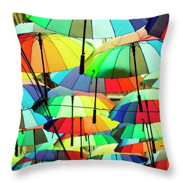 Roof Made From Colorful Umbrellas Throw Pillow
