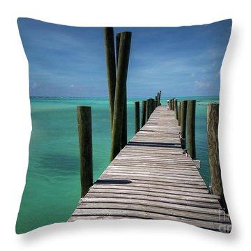 Rum Cay Marina Jetty In Bahamas Throw Pillow by Jola Martysz