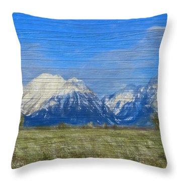 Rustic Grand Teton Range On Wood Throw Pillow by Dan Sproul