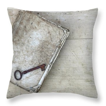 Throw Pillow featuring the photograph Rusty Key On The Old Tattered Book by Michal Boubin
