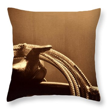 Saddle In A Barn Throw Pillow by American West Legend By Olivier Le Queinec