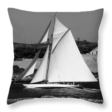 sailboat - a one mast classical vessel sailing in one of the most beautiful harbours Port Mahon Throw Pillow