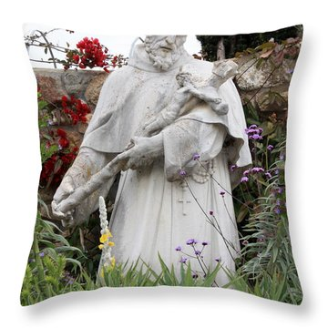 Saint Francis Statue In Carmel Mission Garden Throw Pillow by Carol Groenen
