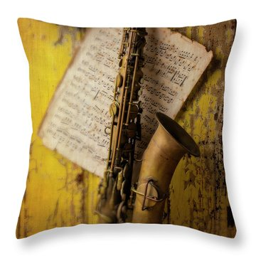 Saxophone Hanging On Old Wall Throw Pillow