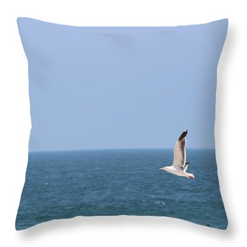 Seagull Flying Over Huntington Beach Throw Pillow