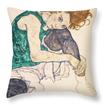 Seated Woman With Legs Drawn Up Throw Pillow