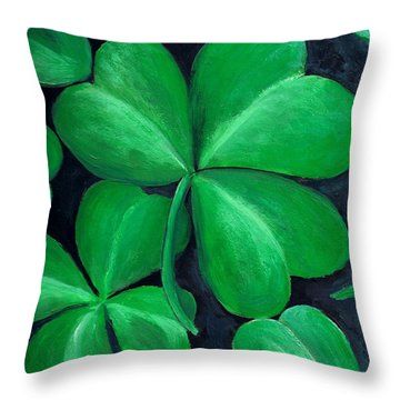 Shamrocks Throw Pillow by Nancy Mueller